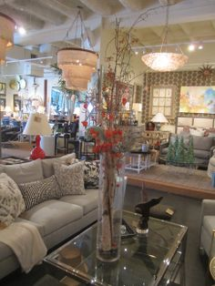 Sofa and table with chandeliers  #Houston #Mecox