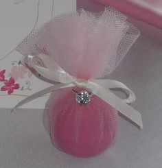 Bridal Shower favor using EOS, wrapped in tulle with faux diamond ring and cute bow.  So easy and a big hit at the shower!