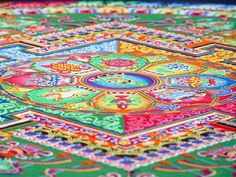The Sand Mandala (tib: kilkhor) is a Tibetan Buddhist tradition involving the creation and destruction of mandalas made from colored sand. A sand mandala is ritualistically destroyed once it has been completed and its accompanying ceremonies and viewing are finished to symbolize the Buddhist doctrinal belief in the transitory nature of material life