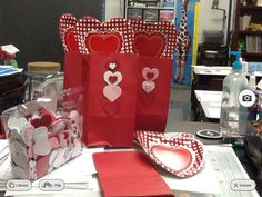 paper bags paper plates and foam heart stickers make easy cheap Valentines day mailboxes