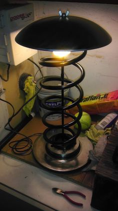 A lamp made from a coil spring and brake disc.