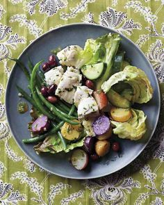 Delicate poached halibut is the star of this fresh springtime take on the classic Nicoise salad.
