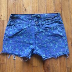 BDG Floral Cut Offs These were originally full length BDG jeans from Urban Outfitters. I cut them myself into shorts -- they are evenly cut! Really cool purple/green/blue floral pattern. BDG Shorts Jean Shorts
