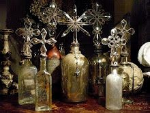 From Greyfreth -- Beautiful crosses of crystal atop mercury glass apothecary bottles from the 1800s, antique leather decanters from Spain, and unearthed bottles over a century old