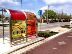 When you visit Indy, include the cultural trail. Many bus shelters are decorated brightly, like this one. (c) GTH & Marc Kassouf
