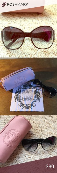 JUICY COUTURE Sunglasses Brand NWOT Juicy Couture Sunglasses with case and cleaning cloth. Black frames with tinted gray lenses. Ask me for measurements if you would like them! Juicy Couture Accessories Sunglasses