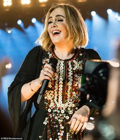 Set f*** to the rain! Adele's 90-minute headline set at Glastonbury Festival on Saturday w...