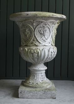 Our larger white urn available for rental with a pedestal for height.
