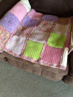Patchwork crochet blanket in pastel colours