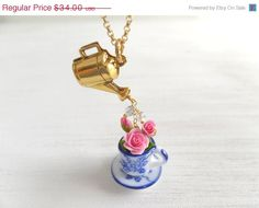 Anyone who dearly loves to garden or has a mad love affair with flowers will enjoy this piece. It is an adorable whimsical pendant of a 3-D bouquet in