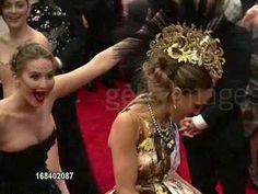 Jennifer Lawrence photobombs Sarah Jessica Parker on the red carpet.