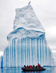 """NOT Lake Michigan!! """"These striking pictures of icebergs with multi-colored stripes or banding were taken by a Norwegian sailor named Oyvind Tangen while he was aboard a research ship about 1,700 miles south of Cape Town, South Africa."""""""