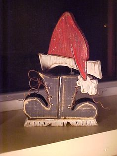 """SANTA Word w/Mittens and Boots  Pattern @Country Feelin': $13.95. Description: This is our smallest pattern ever designed. The North pole stands 6"""" tall You can make this one out of all your scraps. Very simple I love this one."""