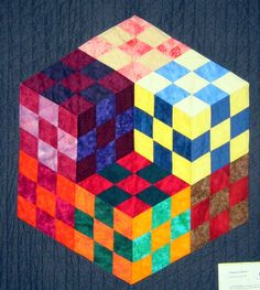 The classic three-dimensional cube illusion illusion rendered as a quilt. Tumbling Blocks Quilt, Quilt Blocks, Cool Illusions, Mini Quilt Patterns, Mariners Compass, Barn Quilts, Mini Quilts, Quilting Designs, Three Dimensional