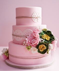 Pink wedding cake with rustic elements.