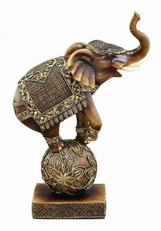 "12"" Trunk Up Circus Elephant On Ball Statue Sculpture. Elephant Statue is hand carved in cold cast solid resin in gold color composition. Dimension: 12""H x 8""W. #FairfieldGrantsWishes"