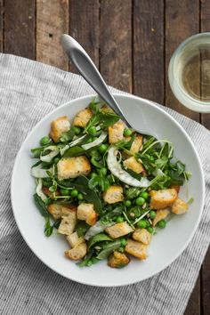 This spring panzanella is a hearty, seasonal salad with fresh peas, fennel, pea shoots, and spinach. Recipe is from The Easy Vegetarian Kitchen Cookbook.