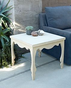 Silhouette White Outdoor Side Table at Neiman Marcus.