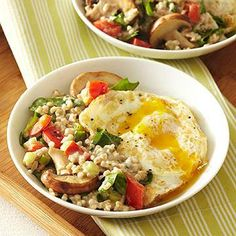 Steel-cut oats--with melted brie and reduced-fat cream cheese--take center stage in this risotto-like breakfast dish. They're mixed with spinach and vegetables and topped with a sunny-side-up fried egg. This hearty breakfast will satisfy you for hours. Diabetic Breakfast Recipes, Healthy Casserole Recipes, Diabetic Recipes, Cooking Recipes, Healthy Recipes, Diabetic Cookbook, Meatless Recipes, Dishes Recipes