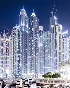 Dubai Marina Stack JAW DROPPING view of Dubai Marina at Night! The tallest block of skyscrapers in the world. Loving this area of Dubai! Photograph by Christian Wiedel