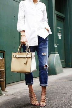 WITH BOYFRIEND JEANS AND STATEMENT ACCESSORIES  Kind of a no-brainer. But it's all in the accoutrements. Upgrade the ol' collared-shirt-and-jeans combo with fierce heels and a statement bag.