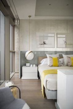 Neutrals with pops of yellow Kelly Hoppen - One Shenzhen Bay