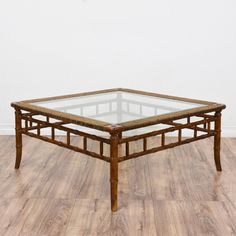This tropical coffee table is featured in a bamboo and rattan with a glossy dark finish. This coffee table is in great condition with a square glass table top, woven trim and carved rail sides. Beach chic table perfect for holding drinks! #tropical #tables #coffeetable #sandiegovintage #vintagefurniture
