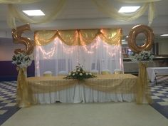 Gold curtain back drop #tapiadecorations