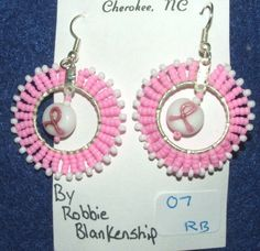 """Earrings Beaded w/ Breast Cancer symbol bead Native American 1.75"""" length  Are you a survivor?  Then these are the earrings for you!  Wear them proudly!  Native American made. Just 25.00 w/ free shipping within the USA. #breastcancer #beadwork #nativeamerican"""