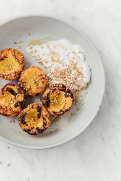 Charred Honey Peaches with Whipped Vanilla Coconut Yoghurt and Toasted Buckwheat