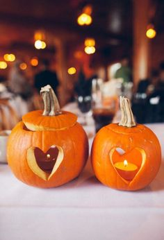 Carve hearts into pumpkins and add candles for #fall centerpieces.