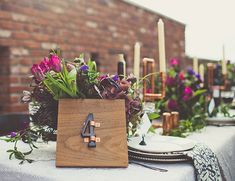 Purple wedding flowers + wood details + copper candlestick holders // fall wedding inspiration