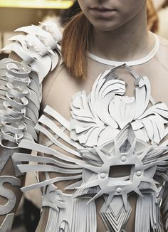 dress with intricate structure using layered leather applique to create dimensionality; Anne Sofie Madsen