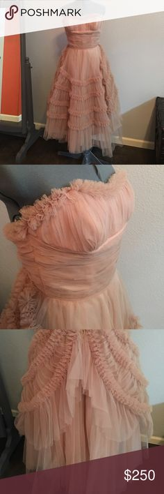 "Vintage Tulle dress This Emma Domb dress is gorgeous. I love it but it does not fit anymore. It says size 12 but it measures a 26"" waist. The chest area measures about 29"" to 30"". It's a champagne color.  The history of the Emma Domb dresses go back to 1938. I have looked into this style and think it's definitely a one of a kind. Dresses Strapless"