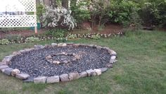 Firepit. I wanted a firepit that looked like a campfire in the woods. We created a circle using a stick tied with a piece of string and chalk. Then we started  digging about  four inches down. We covered the dirt with landscaping  fabric, but not in the inner circle. Then we covered the  whole circle with bags of River pebbles. On top we placed an inner circle of stones. I live in the city and I didn't want really big fires, I'm hoping the small inner circle will encourage us to make smaller…