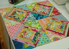 String Quilt. Like the string piecing paired with the larger triangles