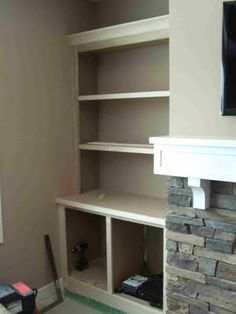 Fireplace built ins, but with room for the TV