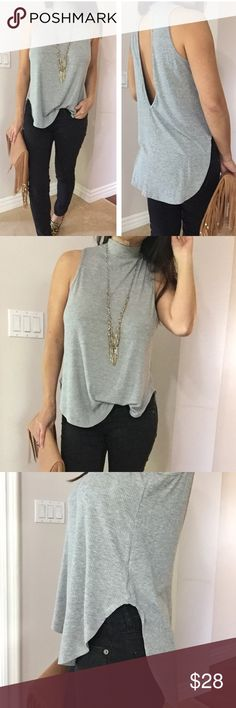 "Ribbed mock neck with back cutout top Brand New, Never Worn.  Chic ribbed sleeveless mock neck with back cutout.  High low style at the bottom.  Great to pair with jeans/Skirts./Shorts.  Stretchy material .  No trades , bundle for 10% discount .  Model is wearing size small 5'3"" Tops Blouses"
