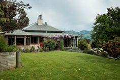 Takamatua Farm Stay   Akaroa – New Zealand Akaroa New Zealand, Farm Stay, Road Trips, Gazebo, Scenery, Outdoor Structures, Cabin, House Styles, Places