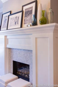 A gas fireplace with bright white wood fireplace mantle provides an intimate focal point for the living room. High contrast photos with dark frames decorate the crisp mantle.