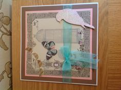 Card made with Kaisercraft long birdcage stamped onto kaisercraft paper with butterfly and memory box serene bird