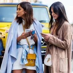 Trench coats add chic flare to june-gloom ensembles.
