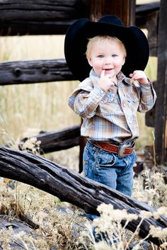 What an awesome picture: Cute cowboy - check, great hat - check, out in the sunshine - check.