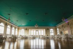 Indoor, Ybor City Wedding Reception Venue with Wood Floors and Green Ceiling with Chandeliers | The Cuban Club