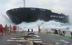 Salvage tug in rough seas.