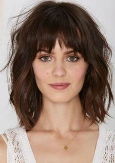 Textured shoulder length bob with bangs
