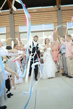 Love the streamers in their wedding colors, made for such a beautiful grand exit! Photographed by Jessica Nadine Photography