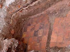 Henry VIII's Private Chapel-2006-Beneath a parking lot, archaeologists discovered not only the Tudor chapel wherein Henry VIII married two of his wives, but also stained glass, the vestry, and a cobbled waterfront path.