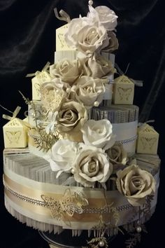 A STUNNING TABLE CENTER PIECE FOR A WEDDING BIRTHDAY PARTY OR BABY SHOWER. A FULL EASY STEP BY STEP TUTORIAL TO MAKE THIS STUNNING CAKE FROM AN OLD BOOK