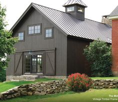 Cabot's 'Burnt Hickory' stain. The manufacturer of the metal roof is Ideal and the color is matte black.